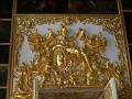 Gold relief over the door