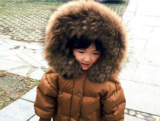 Child with a fur hood