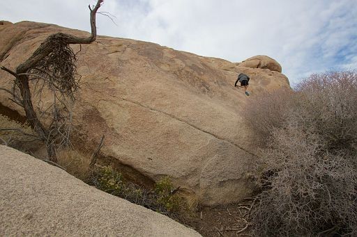 climbing the boulder